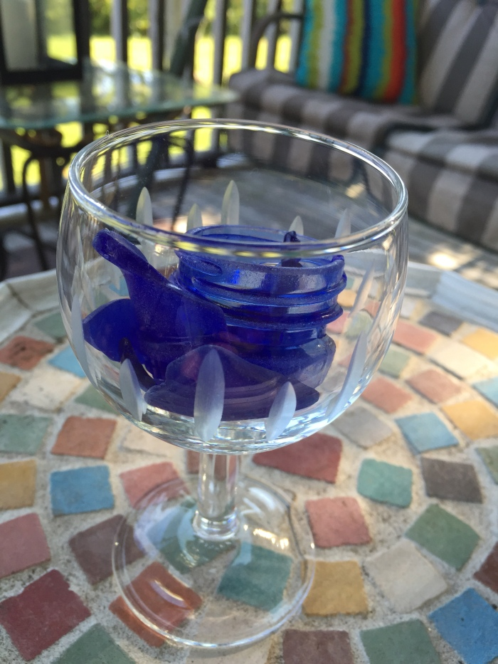 A wine glass of blue! Don't drink it!